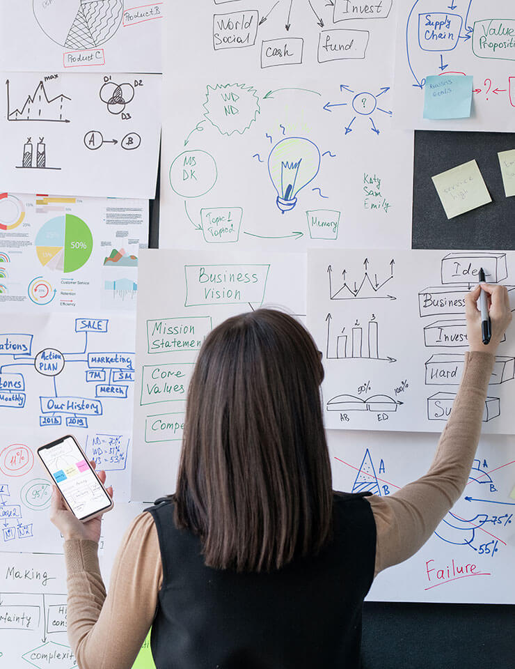Business consultant from business consulting company drawing on white board